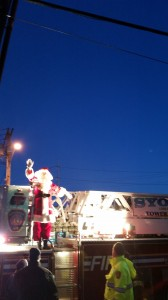 Santa arrives on the Firetruck